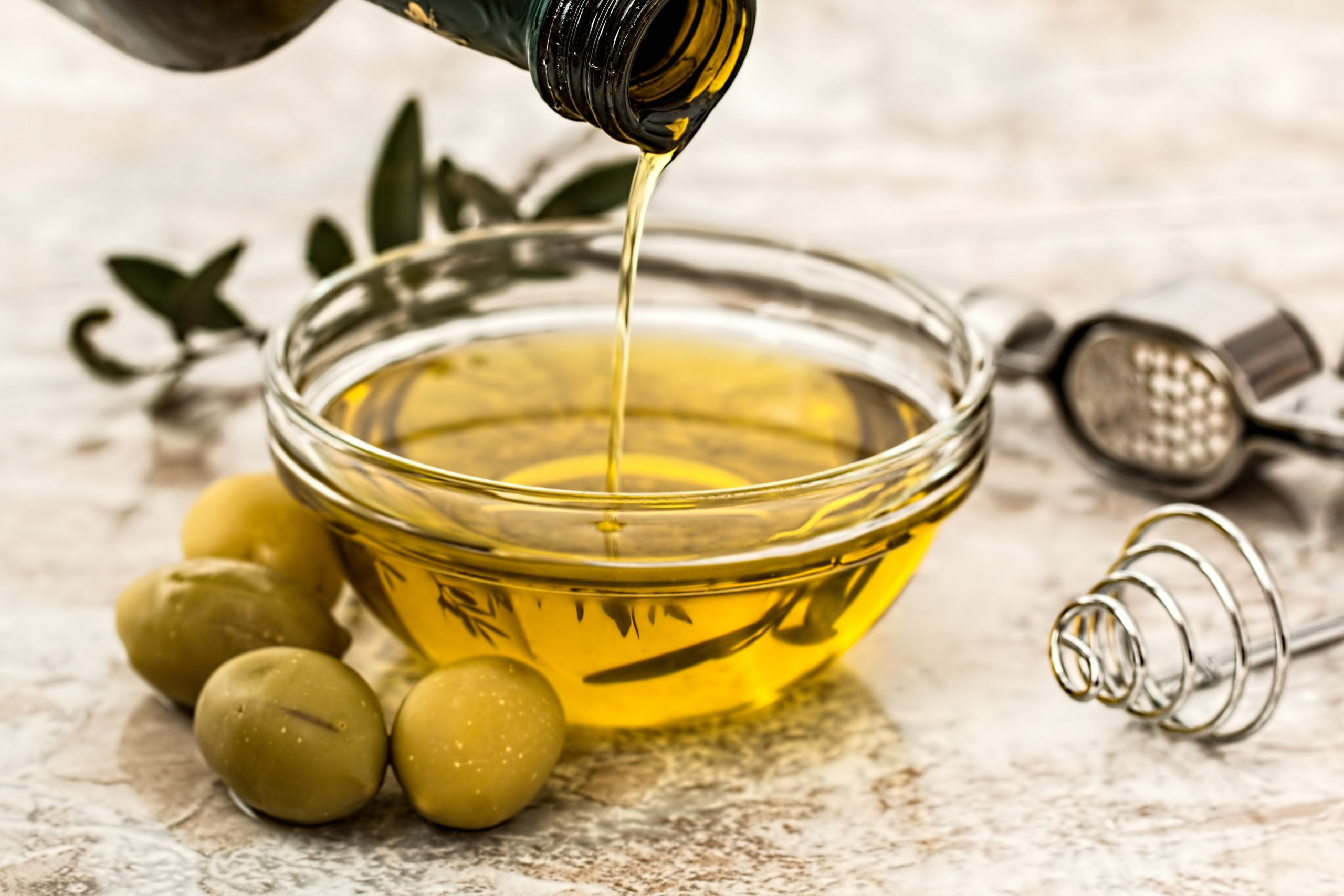 Canva - Olive Oil in a Bowl